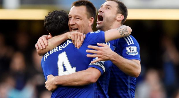 Chelsea's Branislav Ivanovic celebrates at the end of the game with John Terry and Cesc Fabregas