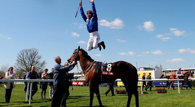Frankie Dettori celebrates his victory on Muhaarar in the Aon Greenham Stakes during the Dubai Duty Free Spring Trials Meeting at Newbury Racecourse