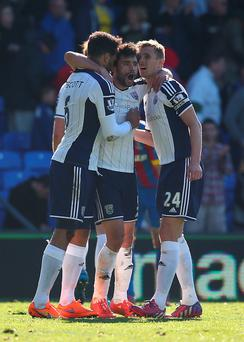 Claudio Yacob of West Brom (C) celebrates with Joleon Lescott and Darren Fletcher