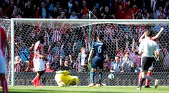 Stoke City's Mame Diouf (left) scores his side's equaliser at the Britannia