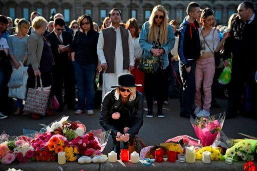 GRIEF: Flowers and candles are left by fellow students and members of the public during a silent vigil for Karen Buckley