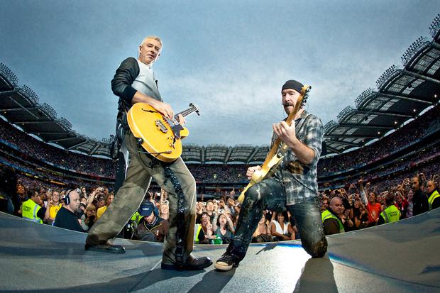 Adam Clayton and The Edge perform on stage for the second night of U2's 360 Degrees World Tour in their home town at Croke Park on July 25, 2009 in Dublin, Ireland.