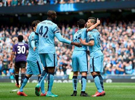 Manchester City's David Silva, Yaya Toure, Jesus Navas and Sergio Aguero (left to right) celebrate West Ham United's James Collins scoring an own goal the Barclays Premier League match at the Etihad Stadium
