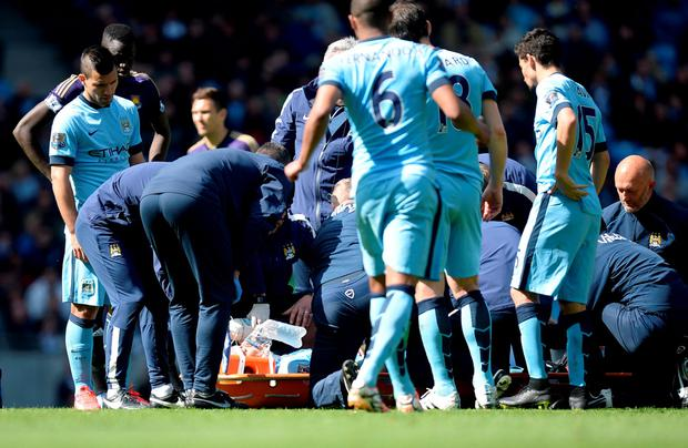 Manchester City's David Silva lies injured on the pitch during the Barclays Premier League match at the Etihad Stadium, Manchester