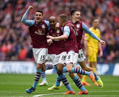 Aston Villa's Fabian Delph (centre) celebrates scoring his side's second goal of the game with team-mates Aston Villa's Ashley Westwood (left), Aston Villa's Tom Cleverley and Aston Villa's Jack Grealish (right)
