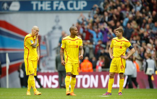 Liverpool's Steven Gerrard (R), Glen Johnson and Martin Skrtel looks dejected at the end of the match