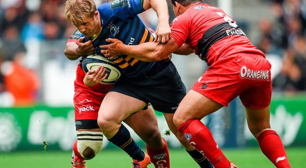 Luke Fitzgerald, Leinster, is tackled by Chris Masoe, right, and Steffon Armitage, RC Toulon