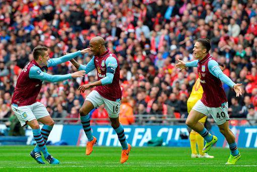 Aston Villa's English midfielder Fabian Delph (C) celebrates with Aston Villa's English midfielder Ashley Westwood (L) after scoring during the FA Cup semi-final