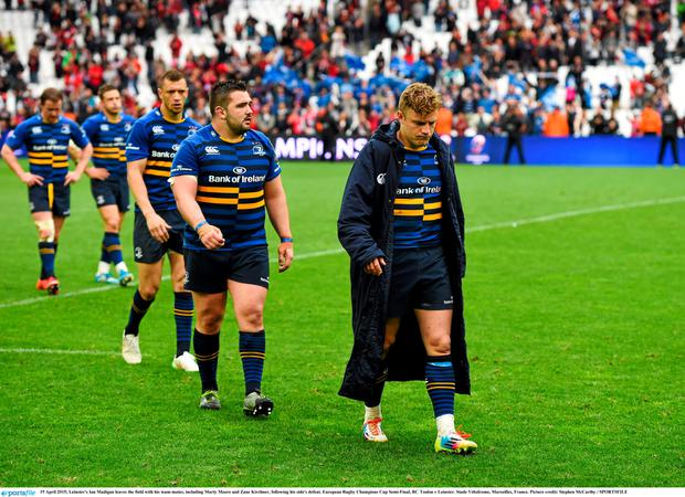 Leinster's Ian Madigan leaves the field with his team-mates, including Marty Moore and Zane Kirchner, following his side's defeat