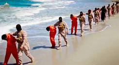This undated image made from a video released by Islamic State militants
