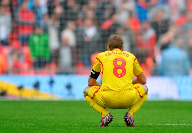 Liverpool's English midfielder Steven Gerrard reacts after losing the FA Cup semi-final between Aston Villa and Liverpool at Wembley stadium in London on April 19, 2015.