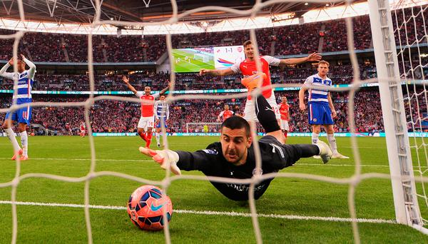 Reading's Adam Federici scrambles for the ball in vain