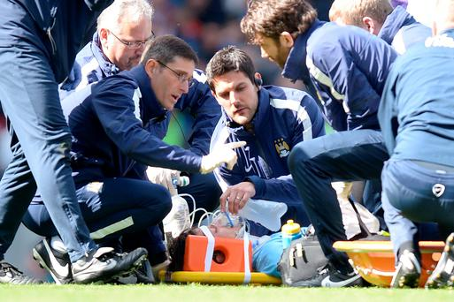 Manchester City's David Silva lies injured on the pitch