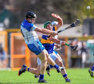 Waterford's Kevin Moran gets the ball away under pressure from Tipperary's James Woodlock during their Allianz NHL