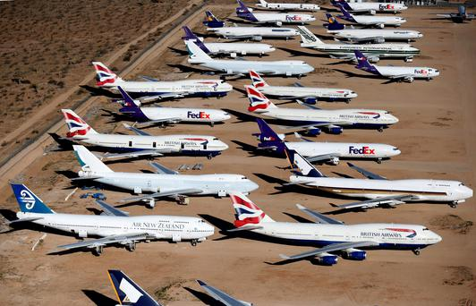 Old airplanes, including British Airways and Air New Zealand Boeing 747-400s, are stored in the desert in Victorville, California