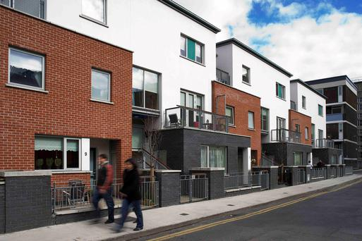 A small 525 square metre site on which nine apartments and duplexes were built across two and three storeys. It includes three one-bed, three two-bed and three three-bed homes on a continuous terrace. Part of St Andrew's Court, the development encloses a courtyard and now includes car parking. All homes are south-facing with balconies