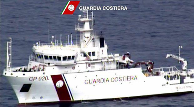 An Italian coast guard vessel is seen during the search and rescue operation underway after a boat carrying migrants capsized overnight, with up to 900 feared dead, in this still image taken from video April 19, 2015