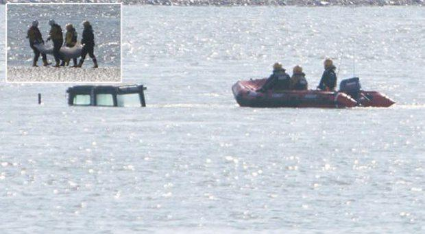 Coastguard crews at the scene where the tops of the fishermen's tractors can be seen in the tide and (inset) the body of missing Bernard Mahony is recovered