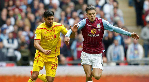 Liverpool's Emre Can in action with Aston Villa's Jack Grealish