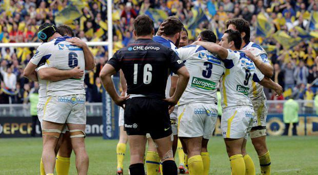 Clermont Ferrand' players celebrate after they won their European Champions Cup semifinal match against Saracens, in Saint-Etienne, central France, Saturday, April 18, 2015