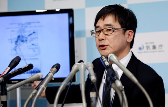 Japan Meteorological Agency's earthquake and volcano observations division director Koji Nakamura points on the map showing the quake centre during a news conference in Tokyo REUTERS/Issei Kato
