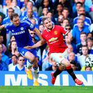 Branislav Ivanovic of Chelsea and Luke Shaw of Manchester United compete for the ball during the Barclays Premier League match between Chelsea and Manchester United at Stamford Bridge