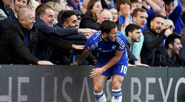 Chelsea's Eden Hazard with fans after a missed chance