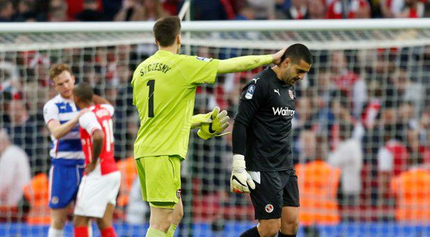 Reading's Adam Federici is consoled by Arsenal's Wojciech Szczesny at the end of the match