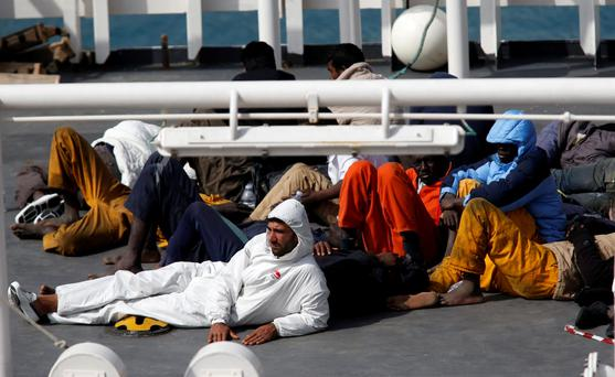 Surviving immigrants lie on the deck of Italian coastguard ship Bruno Gregoretti in Senglea, in Valletta's Grand Harbour REUTERS/Darrin Zammit Lupi