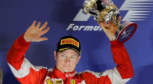Ferrari Formula One driver Kimi Raikkonen of Finland celebrates his second place on the podium after Bahrain's F1 Grand Prix at Bahrain International Circuit, south of Manama April 19, 2015