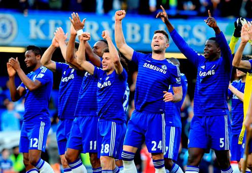 Chelsea players celebrate victory with teammates after the Barclays Premier League match at Stamford Bridge on Saturday