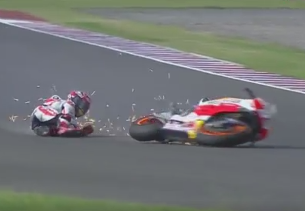 Marc Marquez crashes after coming into contact with Valentino Rossi