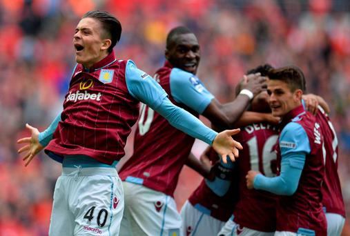 Aston Villa's English midfielder Jack Grealish celebrates Villa's second goal during the FA Cup semi-final between Aston Villa and Liverpool at Wembley stadium yesterday