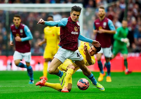 Emre Can tackles Jack Grealish during the FA Cup Semi Final between Aston Villa and Liverpool at Wembley