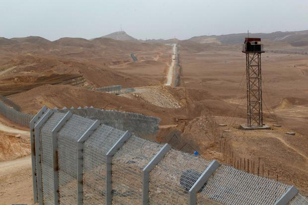 The Israel–Egypt border fence is 245 miles in length Credit: Baz Ratner