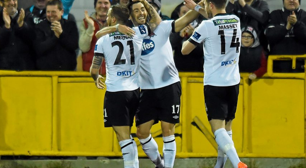 Dundalk's Richie Towell is congratulated by team-mates Darren Meenan, left, and Dane Massey, right, after scoring his side's third goal against Galway United at Oriel Park. Picture credit: Paul Mohan / SPORTSFILE