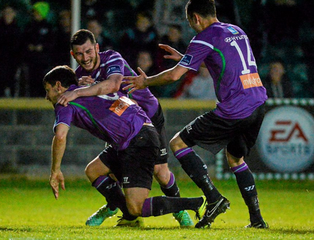 Maxime Blanchard, Shamrock Rovers, celebrates scoring his side's third goal with team-mates Ryan Brennan and David Webster,