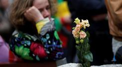Flowers are seen, during a silent commemoration for the victims of a boat accident, in Vienna (REUTERS/Leonhard Foeger)