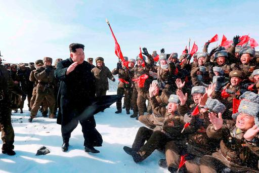 North Korean leader Kim Jong Un greets Korean People's Army pilots during a visit to the summit of Mt Paektu. Photo: Reuters