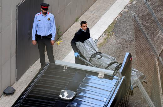 Undertakers remove the body of a teacher who was killed with a crossbow bolt at the Joan Fuster school in Barcelona. Photo: Getty Images