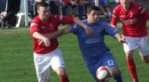 Jay Hart (right) in action for Clitheroe FC
