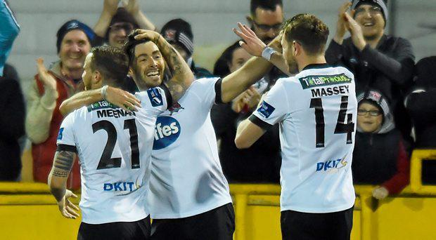 Richie Towell, Dundalk, is congratulated by team-mates Darren Meenan, left, and Dane Massey, right, after scoring his side's third goal