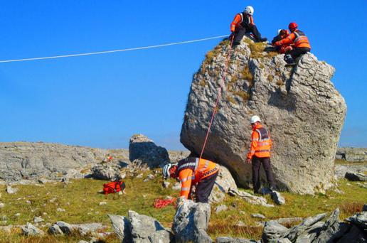 Members of the Doolin and Kilkee units of the Irish Coast Guard rescue a 6-year-old boy who got stuck on top of this 4m high boulder in the Burren. The boys mother flagged down a passing bus to raise the alarm. Photo: Caitr?ona Lucas, Doolin Coast Guard