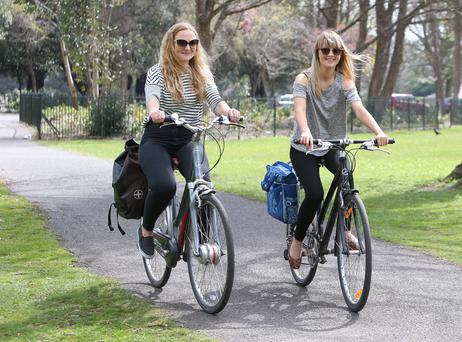 Emma rutter, 19, left, charley cross, 19, from bath, England enjoying a cycle in the phoenix park. Photo: Damien Eagers