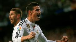 Real Madrid's James Rodriguez celebrates his goal against Malaga during their Spanish First Division soccer match at Santiago Bernabeu stadium in Madrid, April 18, 2015