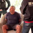 Screen grabbed image taken from video issued by Guardia Civil of armed police capturing one of the UK's most wanted fugitives, Paul Monk, at his luxury villa in Alicante, Spain. Photo: Guardia Civil/PA Wire