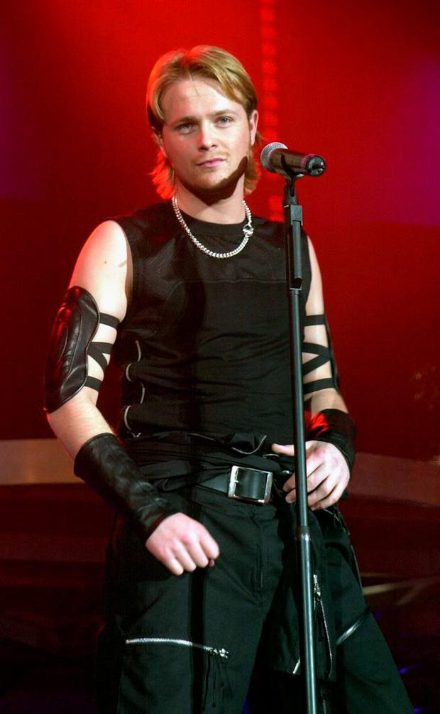 Singer Nicky Byrne of the Irish pop group Westlife performs at a concert in London Arena April 17, 2003 in London, United Kingdom. (Photo by Getty Images)
