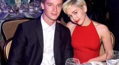 Recording artist Miley Cyrus (R) and Patrick Schwarzenegger attend the Pre-GRAMMY Gala and Salute to Industry Icons honoring Martin Bandier at The Beverly Hilton Hotel on February 7, 2015 in Los Angeles, California. (Photo by Larry Busacca/Getty Images)