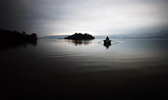 A man rows by the uninhabited Isle of Innisfree in Lough Gill, Co. Sligo circa 1968. Photo: RDImages/Epics/Getty Images
