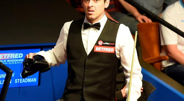 Ronnie O'Sullivan, who suffered a broken ankle at the end of last year, appeared in discomfort due to his footwear at one point and opted to remove his shoes, briefly playing on in his socks